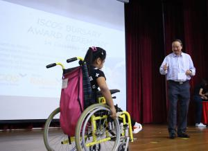 Sheng Siong giving out awards-min